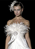 Wedding dresses with feathers and black embroidery are a total hit